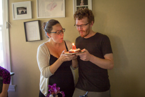 blowing candle on birthday zero